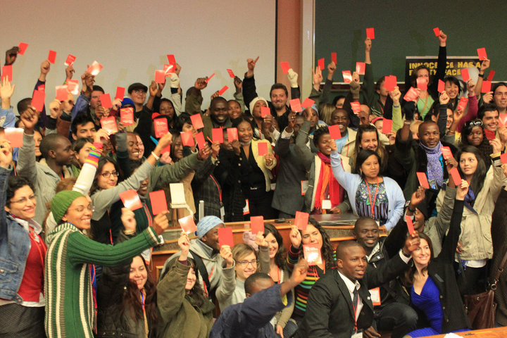 Over 100 Young Leaders waving a Red Card at the founding summit at the 2010 World Cup in Johannesburg, ZA